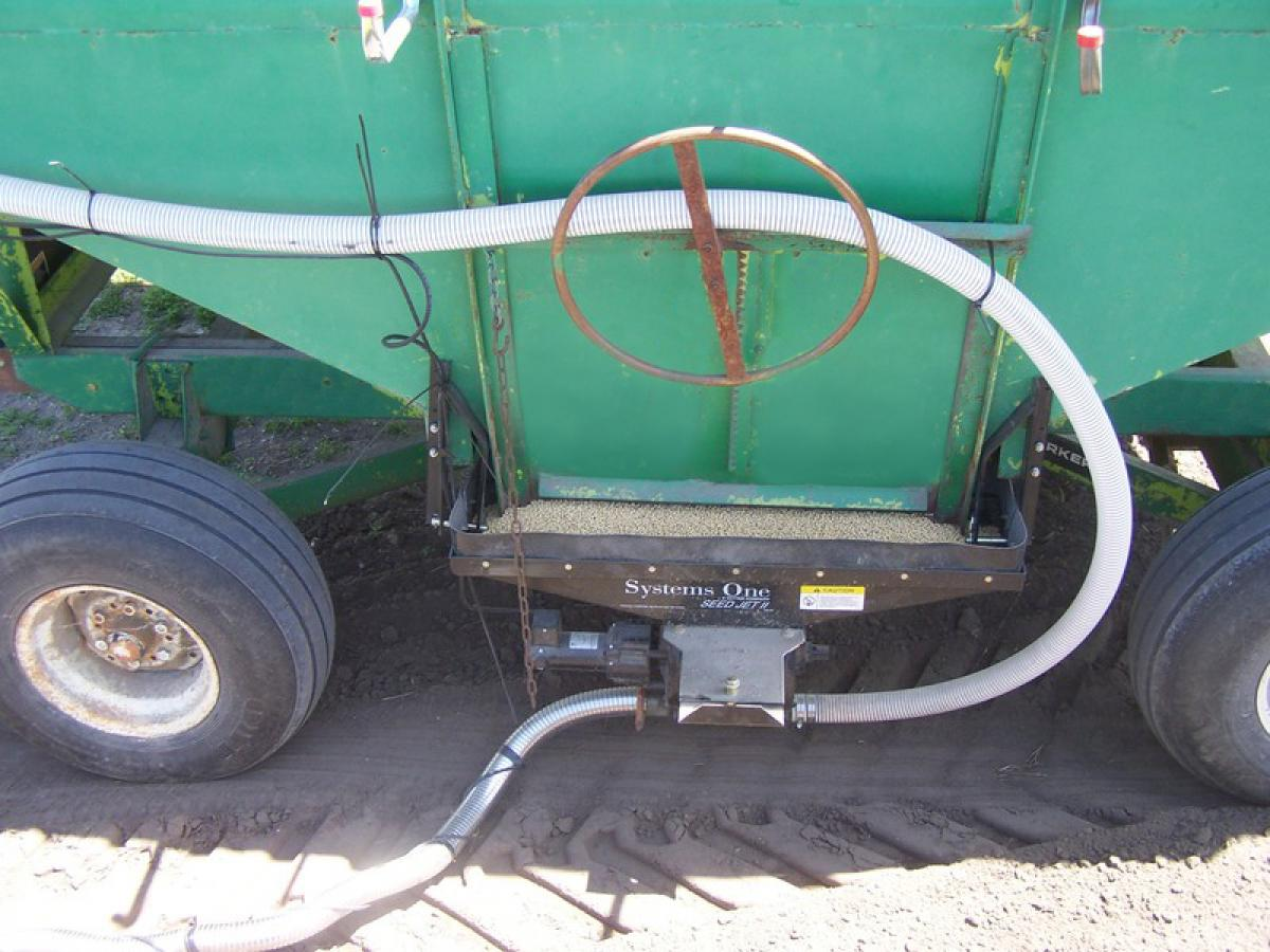 The Seed Jet sends a stream of air through a rotating air lock, sending seed out through hose to fill the planter or drill.