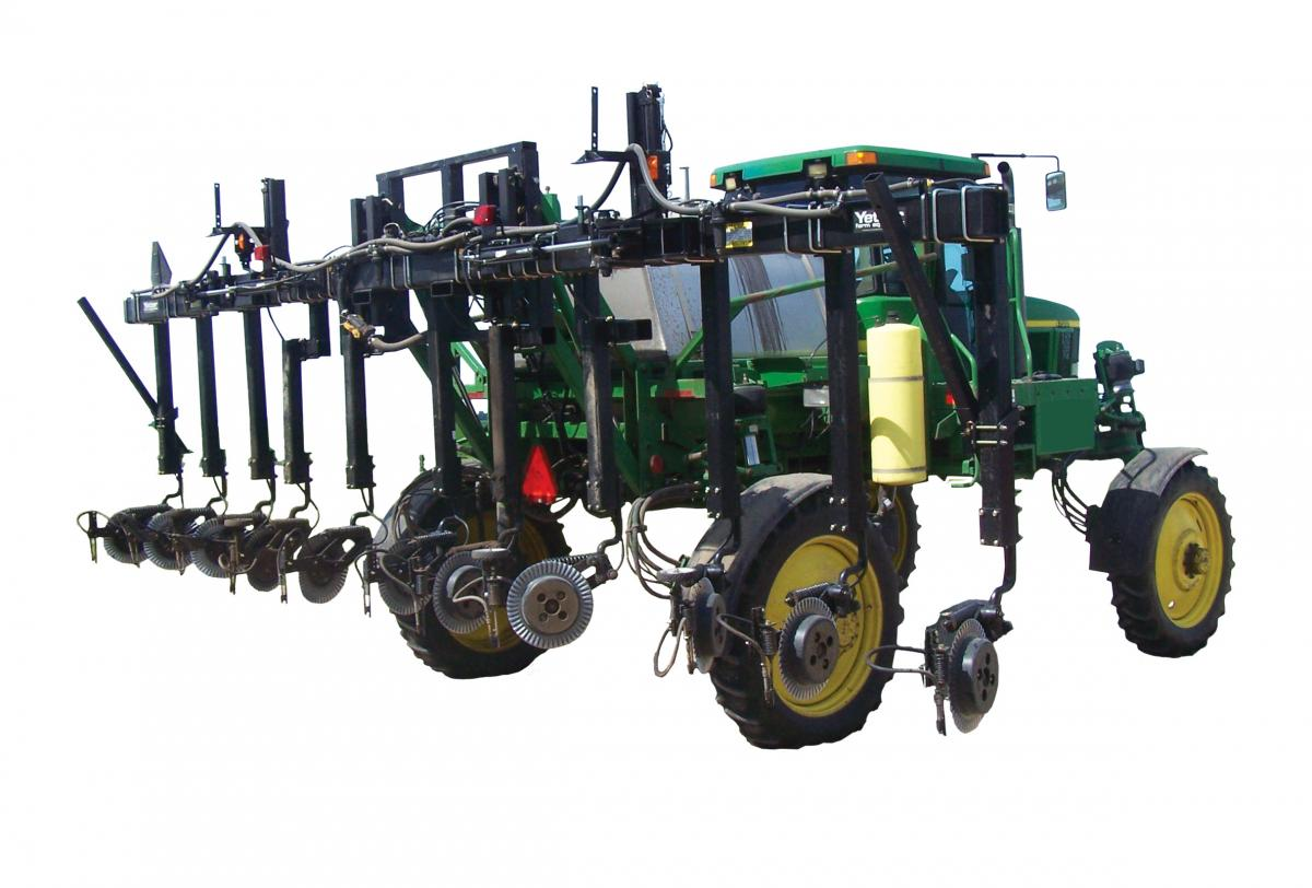 The Yetter 3600 Fertilizer toolbar lifted high