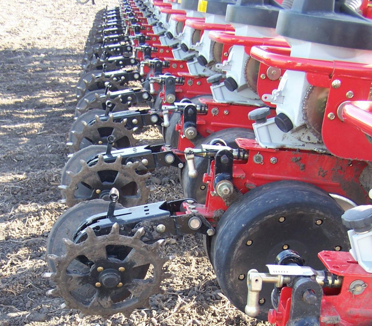 multiple rows of cast spike closing wheels paired with factory rubber closing wheels