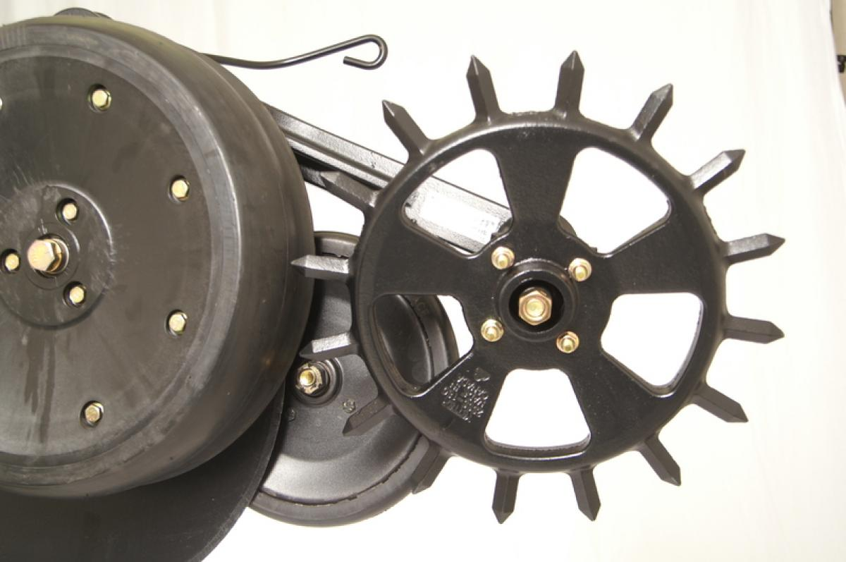 close up of a single cast spike closing wheel