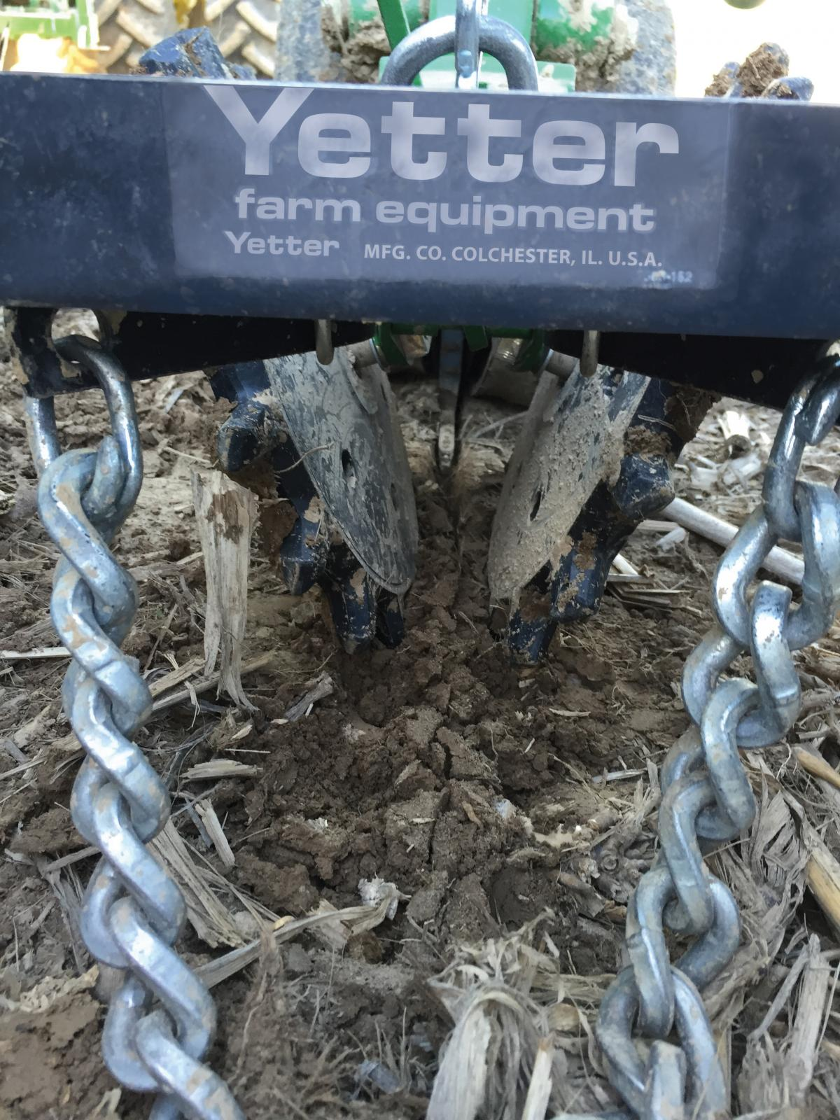 close up of the twisters zipping the seed trench closed