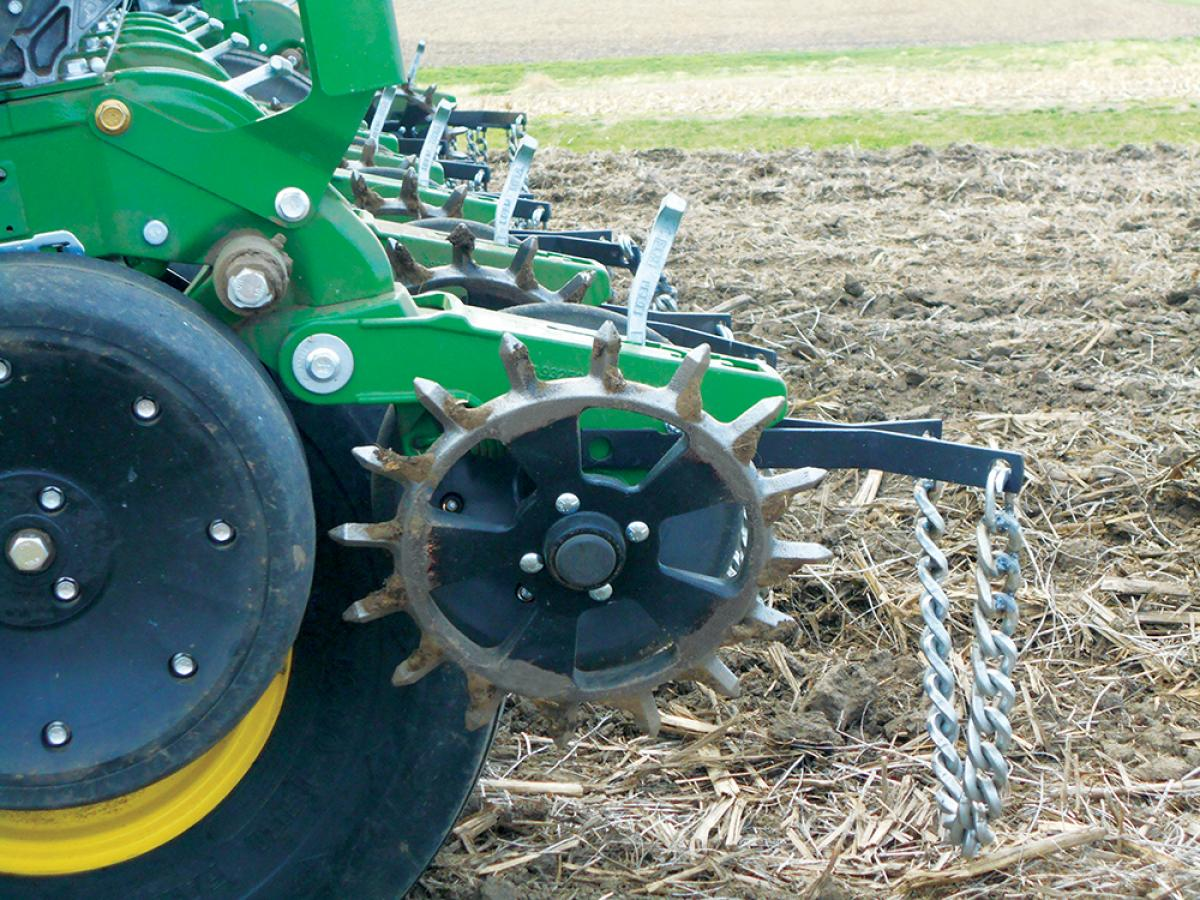 cast iron spikes with yetter drag chains just after closing the seed trench