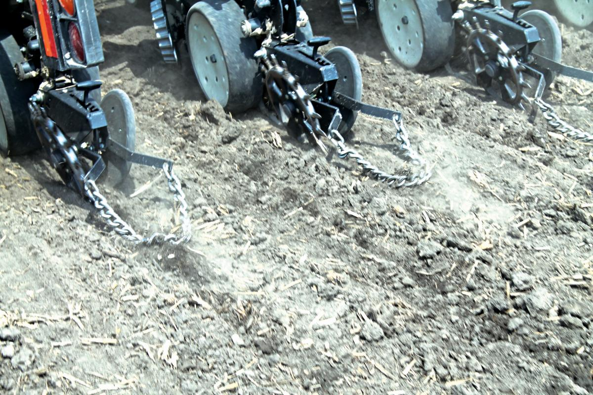 cast spike closing wheels with the yetter drag chains closing the seed trench