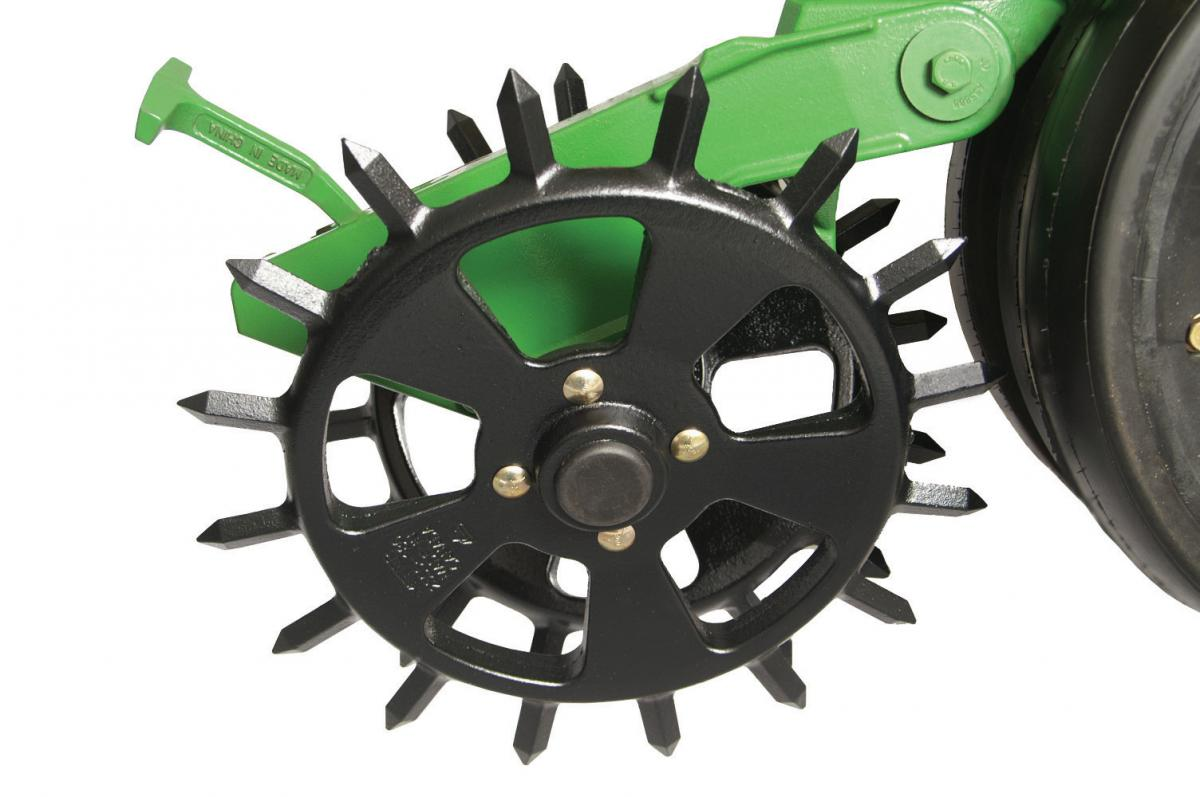 The cast iron spike closing wheel