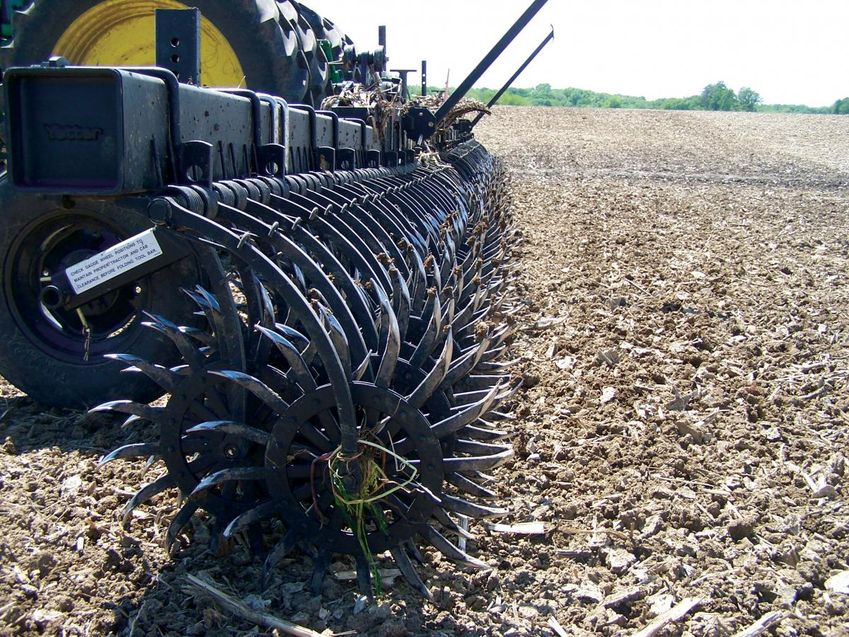 The Conventional rotary hoe running in the field