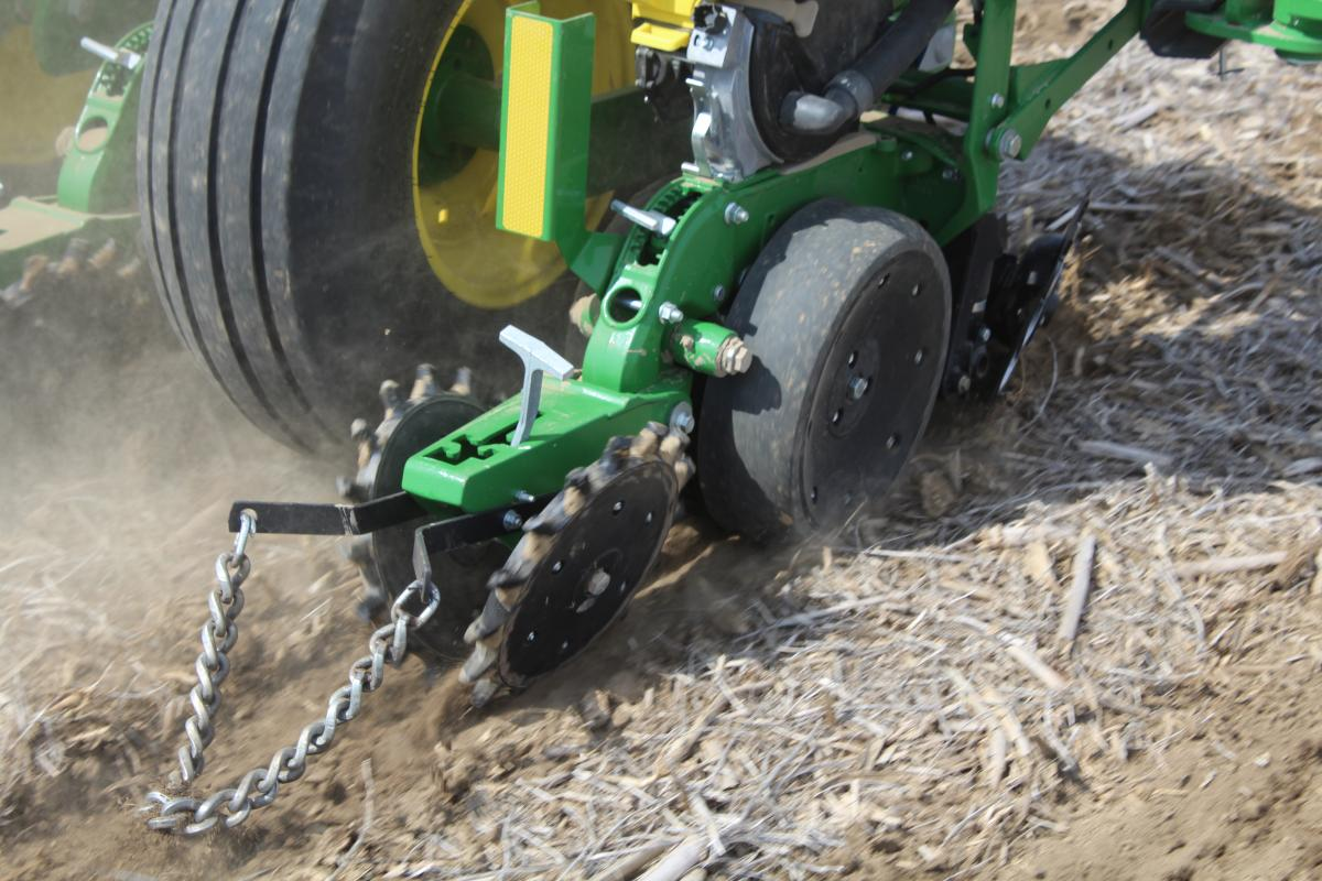 a great angle showing the twister closing wheel zipping the seed trench closed and the optional drag chain behind it