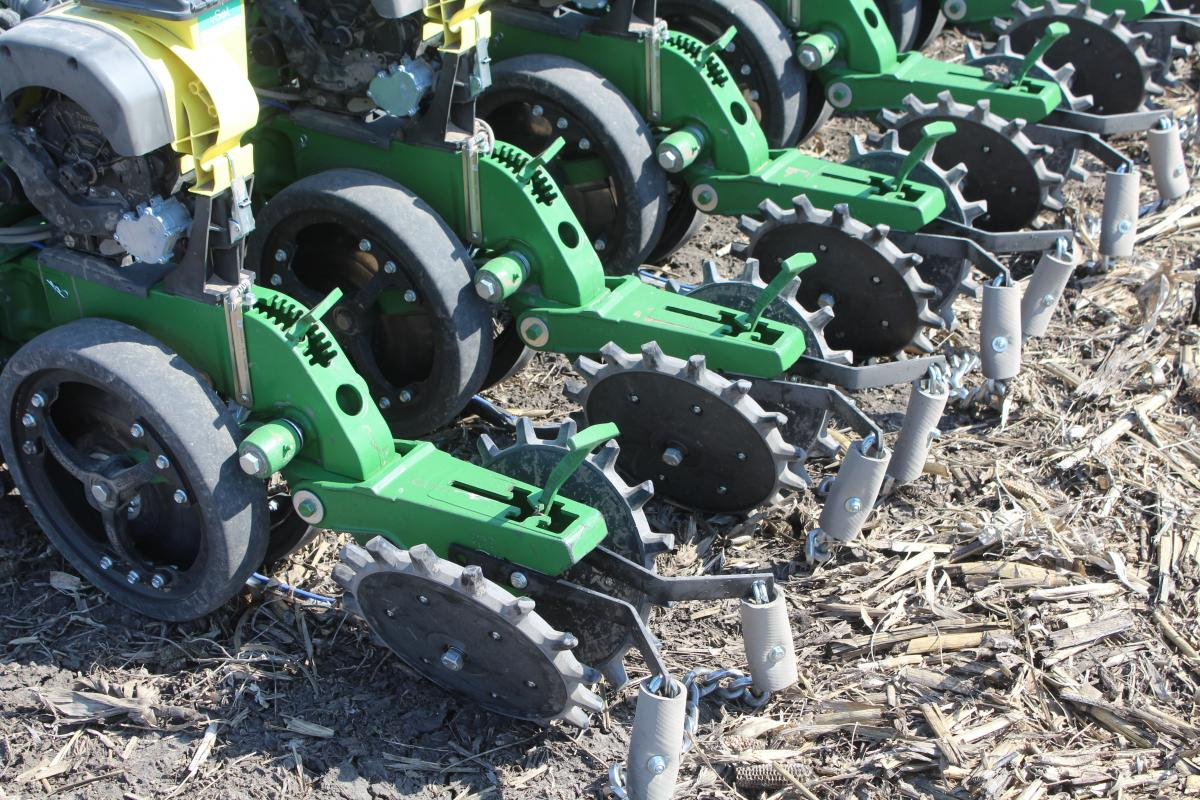 twister closing wheels in the field closing the seed slot with optional drag chain
