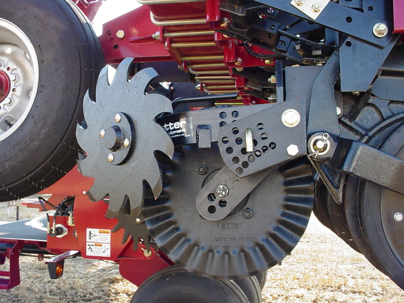 Close up of the 2967-008 Floating Row Cleaner in the locked position for no-till coulters in the field