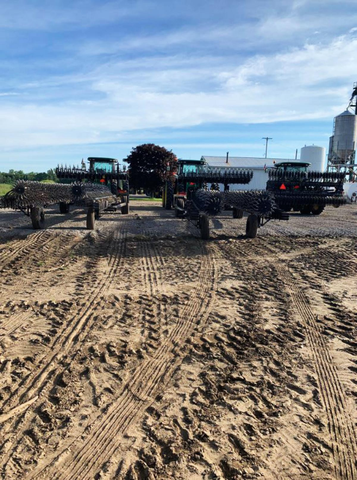 Back transport view of three Yetter rotary hoes