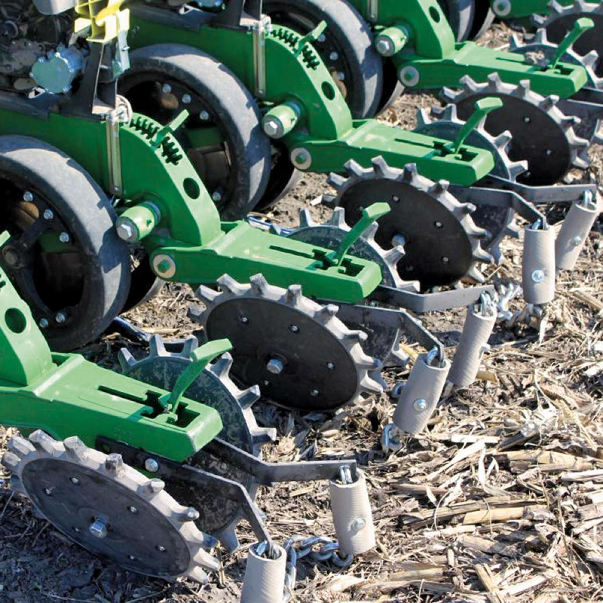 A row of Twister Closing Wheels installed on John Deere planter